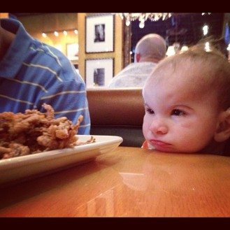 We went out to eat this weekend and Brax just stared at the food. Think he was bummed he couldn't reach out with his hands for it. Too cute though!