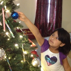 Big sister decorating the tree