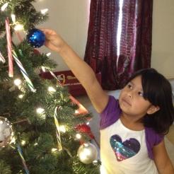 Big sister decorating the tree