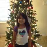 Aileen was proud to decorate the tree her own way