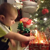Braxton reaching for the presents