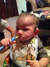 Braxton can manage to get the spoon in his mouth on his own now! yay!