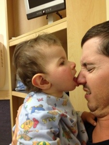 Trying to eat daddy's nose