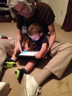 Braxton using an iPad in therapy