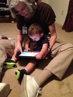 Braxton using an iPad in therapy