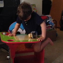 Braxton climbing in to his chair getting ready to eat!