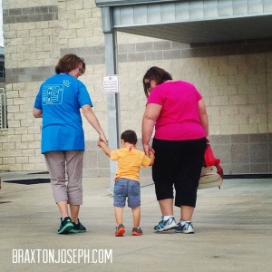 Braxton walking with his teachers