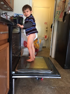 Braxton, doing typical toddler things, like climbing on the oven. (It wasn't on and it's now locked and secured)