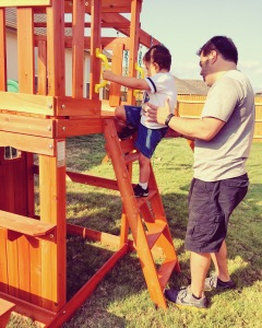 Braxton working with Gil on our playset